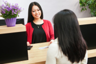 stock-photo-19780195-asian-woman-bank-teller-serving-customer-approaching-retail-bank