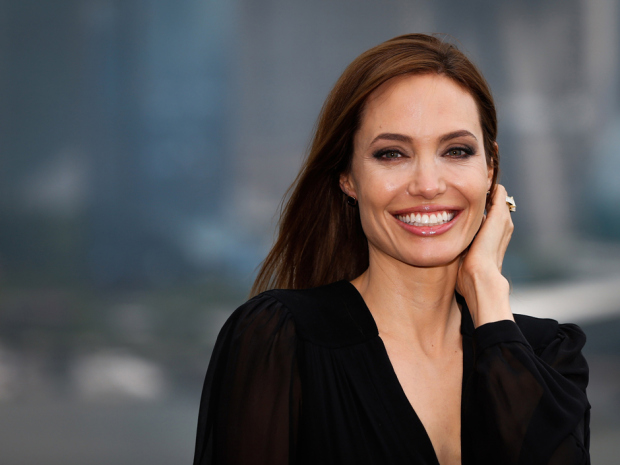 "US actress Angelina Jolie poses on the terrace of a hotel in Shanghai during a press event on June 3, 2014. Jolie said that she was thrilled her latest film ""Maleficent,"" a modern retelling of the life of Sleeping Beauty's arch-nemesis, had debuted at the top of the box office. CHINA OUT AFP PHOTOSTR/AFP/Getty Images"