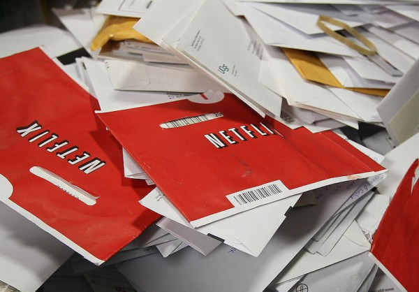 SAN FRANCISCO - MARCH 30:  Red Netflix envelopes sit in a bin of mail at the U.S. Post Office sort center  March 30, 2010 in San Francisco, California.  If the U.S. Postal Service wins its bid to drop Saturday delivery service, customers of the popular online video rental company Netflix could see gaps in DVD delivery and will have to do without Saturday delivery, a popular day to receive movies. (Photo by Justin Sullivan/Getty Images)